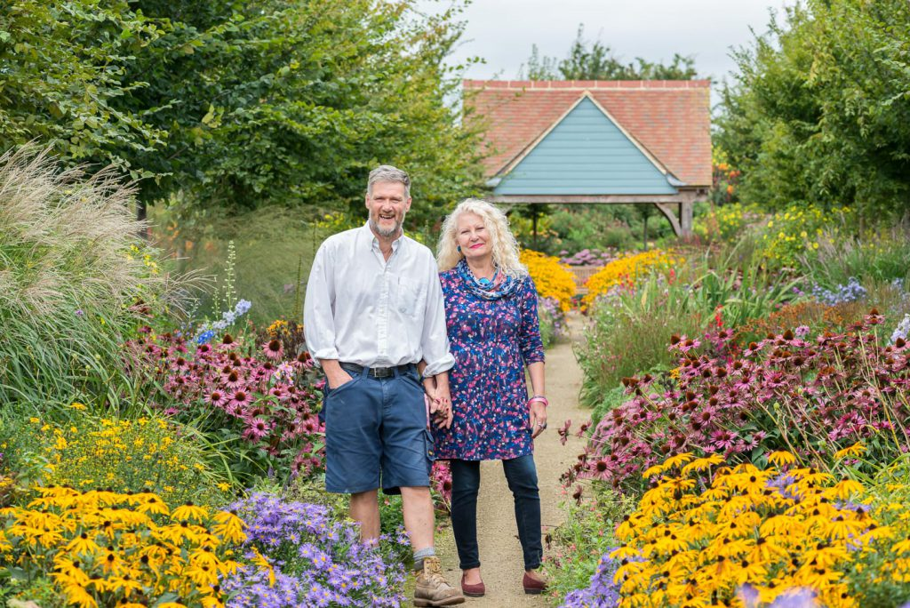 Stephen and Jane Baughan, in the 68-metre-long herbaceous border Stephen has created outside their business, Aston Pottery. The flowers inspire motifs on their pottery.