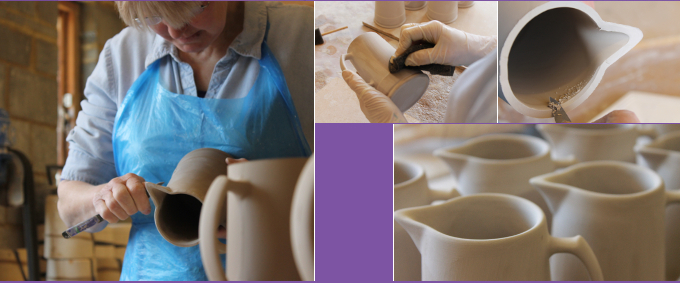 fettling and sponging jugs in the workshop
